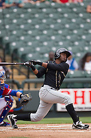 Omaha Storm Chasers shortstop Irving Falu #12 follows through on his swing against the Round Rock Express in the Pacific Coast League baseball game on April 7, 2013 at the Dell Diamond in Round Rock, Texas. Omaha beat Round Rock 5-2, handing the Express their first loss of the season. (Andrew Woolley/Four Seam Images).