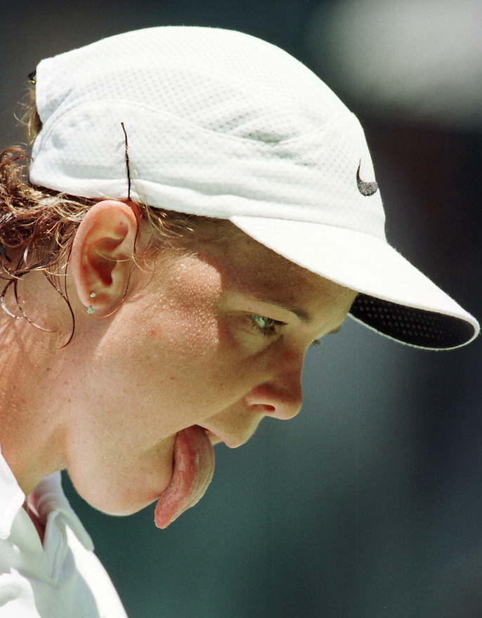 America's Lindsay Davenport from Newport Beach, Ca; sticks out her tongue during her center court loss by 4-6, 7-5, 7-5, to Amelie of France at the Australian Open Tennis Championships, Melbourne, Australia, Thursday, January 28, 1999.(AP Photo/Trevor Collens)