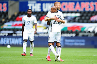 Andre Ayew of Swansea City celebrates scoring his side's second goal with team mate Mike van der Hoorn during the Sky Bet Championship match between Swansea City and Sheffield Wednesday at the Liberty Stadium in Swansea, Wales, UK. Sunday 05 July 2020