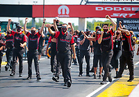 Aug 9, 2020; Clermont, Indiana, USA; Crew members for NHRA top fuel driver Steve Torrence celebrate after winning the Indy Nationals at Lucas Oil Raceway. Mandatory Credit: Mark J. Rebilas-USA TODAY Sports