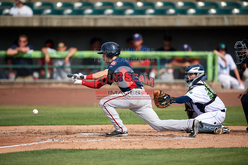 Potomac Nationals second baseman David Masters (8) lays down a bunt in front of catcher Logan Ice (20) during the first game of a doubleheader against the Lynchburg Hillcats on June 9, 2018 at Calvin Falwell Field in Lynchburg, Virginia.  Lynchburg defeated Potomac 5-3.  (Mike Janes/Four Seam Images)