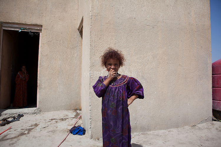 AL-SELKHA, IRAQ: A portrait of a young girl in the village of Al Selkha...Dozens of families displaced by years of violence live in the village of Al Selkha in Nasiriya...Photo by Ali Arkady/Metrography