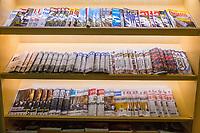 Bangkok, Thailand.  International Newspapers and Magazines, Suvarnabhumi Airport Departure Lounge.