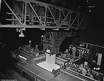 Pittsburgh PA:  View of steel molds in furnace pit.  Swindell Dressler International Company was based in Pittsburgh, Pennsylvania. The company was founded by Phillip Dressler in 1915 as American Dressler Tunnel Kilns, Inc.  In 1930, American Dressler Tunnel Kilns, Inc. merged with William Swindell and Brothers to form Swindell-Dressler Corporation. The Swindell brothers designed, built, and repaired metallurgical furnaces for the steel and aluminum industries. The new company offered extensive heat-treating capabilities to heavy industry worldwide.