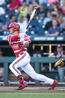 Louisville Cardinals outfielder Lucas Dunn (7) follows through on his swing during Game 10 of the NCAA College World Series against the Mississippi State Bulldogs on June 20, 2019 at TD Ameritrade Park in Omaha, Nebraska. Louisville defeated Mississippi State 4-3. (Andrew Woolley/Four Seam Images)