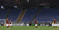 Calcio, Europa League: Ritorno degli ottavi di finale Roma vs Fiorentina. Roma, stadio Olimpico, 19 marzo 2015.<br /> From left, Roma's Daniele De Rossi, Miralem Pjanic, Jose' Holebas and Kostas Manolas enter the pitch to start the second half of the Europa League round of 16 second leg football match between Roma and Fiorentina at Rome's Olympic stadium, 19 March 2015. In background, the Roma fans' Curva Sud half-empty after Fiorentina scored three goal in the first half.<br /> UPDATE IMAGES PRESS/Riccardo De Luca