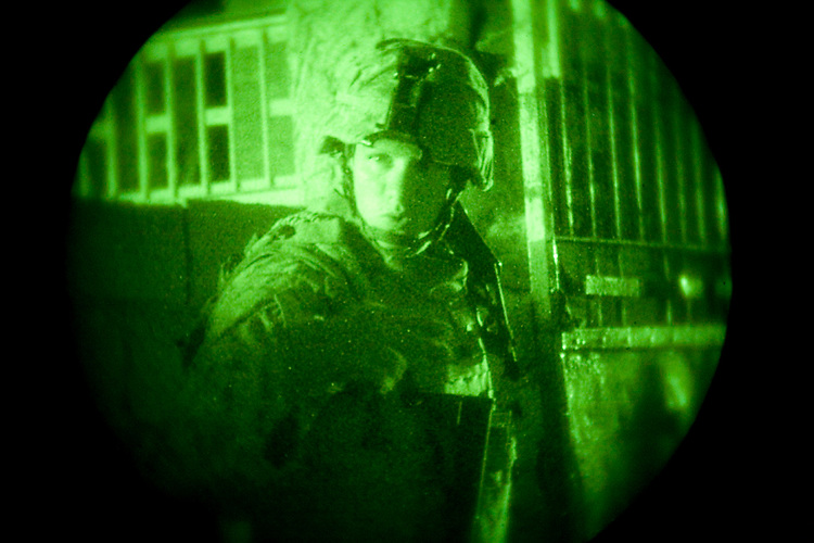 20 September 2007, Sgt. Josh S. Lynos with 2nd Platoon, Charlie Company, 1st Battalion, 7th Marine Regiment, waves for his Marines to hurry up when exiting a palm grove during a patrol through Hit, Iraq. The 2nd Platoon Marines are conducting a security patrol to establish a coalition presence in the city. 1/7 is deployed with Multi National Forces-West in support of Operation Iraqi Freedom in the Al Anbar province of Iraq to develop Iraqi Security Forces, facilitate the development of official rule of law through democratic reforms, and continue the development of a market based economy centered on Iraqi reconstruction. (Official USMC photograph by Cpl. Shane S. Keller)