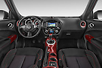 Stock photo of straight dashboard view of a 2015 Nissan JUKE TEKNA 5 Door SUV 2WD Dashboard