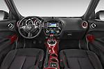Stock photo of straight dashboard view of a 2015 Nissan JUKE TEKNA 5 Door SUV 2WD Dashboard