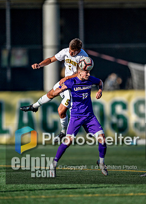 5 October 2019: University at Albany Great Dane Midfielder Niklas Roessler, a Junior from Stuttgart, Germany, heads one away from University of Vermont Catamount Forward Lucas Shaw, a Senior from South Burlington, VT, in the second half at Virtue Field in Burlington, Vermont. The Catamounts fell to the visiting Danes 3-1 in America East, Division 1 play. Mandatory Credit: Ed Wolfstein Photo *** RAW (NEF) Image File Available ***