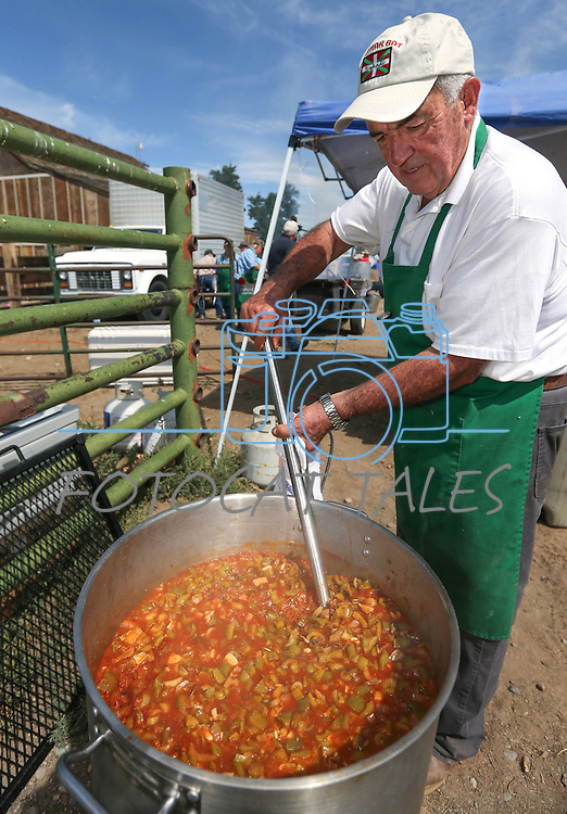 """Jesus Rey stirs a pot of """"lamb ball stew"""" at the Inaugural Basque Fry event in Gardnerville, Nev., on Saturday, Aug. 15, 2015. Approximately 1,500 people attended to hear a handful of Republican presidential candidates speak.<br /> Photo by Cathleen Allison"""