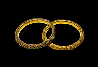 Bronze Age Hattian gold bracelet  from a possible Bronze Age Royal grave (2500 BC to 2250 BC) - Alacahoyuk - Museum of Anatolian Civilisations, Ankara, Turkey. Against a black background