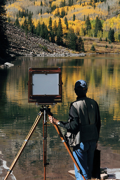 Photographer using an old fashion view camera at the Maroon Bells, Colorado, John offers fall foliage photo tours throughout Colorado.