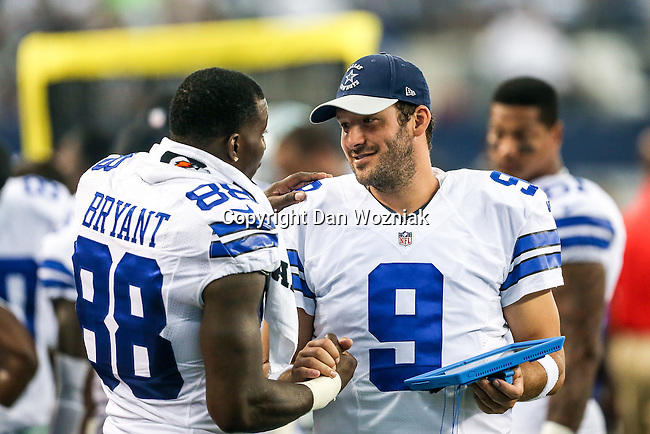 Dallas Cowboys quarterback Tony Romo (9) and Dallas Cowboys wide receiver Dez Bryant (88) in action during the pre-season game between the Baltimore Ravens and the Dallas Cowboys at the AT & T stadium in Arlington, Texas. The Ravens lead Dallas 24 to 10 at half time.
