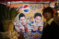 CHINA. Shanghai. An advertisement in a market. 2008.
