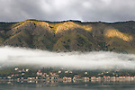 Fog over the Bay of Kotor and a small village, Kotor, Montenegro