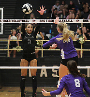 Kennedy Phelan (4) of Fayetteville tries to get through block of Trinity Hamilton (3) of Bentonville on  Thursday, Oct.  7, 2021, during play at Tiger Arena in Bentonville. Visit nwaonline.com/211008Daily/ for today's photo gallery.<br /> (Special to the NWA Democrat-Gazette/David Beach)