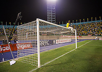 Kingston, Jamaica - Friday, September 7, 2012: The USMNT lost to Jamaica 2-1 during World Cup Qualifying at National Stadium. A Jamaican fan sits on the goal after the game.