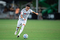 LAKE BUENA VISTA, FL - JULY 31: Eduard Atuesta #20 of LAFC kicks the ball during a game between Orlando City SC and Los Angeles FC at ESPN Wide World of Sports on July 31, 2020 in Lake Buena Vista, Florida.