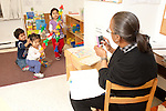 Education preschool education professional video taping children at play in preschool classroom