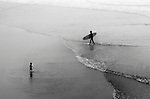 Toddler meets surfer, Huntington Beach, CA.