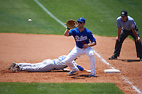 Tulsa Drillers first baseman Lars Anderson (16) waits for a throw as Matt Angle (29) dives back to first during a game against the Midland RockHounds on June 3, 2015 at Oneok Field in Tulsa, Oklahoma.  Midland defeated Tulsa 5-3.  (Mike Janes/Four Seam Images)