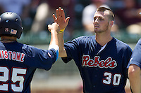 Catcher Will Allen #30 of the Ole Miss Rebels greets teammate Andrew Mistone #25 after he scored during the NCAA Regional baseball game against the Texas Christian University Horned Frogs on June 1, 2012 at Blue Bell Park in College Station, Texas. Ole Miss defeated TCU 6-2. (Andrew Woolley/Four Seam Images).