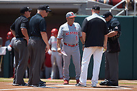 North Carolina State Wolfpack head coach Elliott Avent (9) meets at home plate with Northeastern Huskies head coach Mike Glavine and the umpiring crew prior to their game at Doak Field at Dail Park on June 2, 2018 in Raleigh, North Carolina. The Wolfpack defeated the Huskies 9-2. (Brian Westerholt/Four Seam Images)
