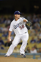 Los Angeles Dodgers pitcher Chad Billingsley #58 pitches against the Arizona Diamondbacks at Dodger Stadium on September 13, 2011 in Los Angeles,California. Arizona defeated Los Angeles 5-4.(Larry Goren/Four Seam Images)