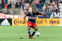 FOXBOROUGH, MA - JULY 7: Andrew Farrell #2 of New England Revolution passes the ball during a game between Toronto FC and New England Revolution at Gillette Stadium on July 7, 2021 in Foxborough, Massachusetts.