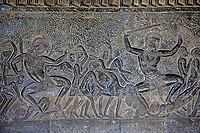 Cambodia, Angkor Wat.  Bas-relief Stone Carving Depicting Scenes from the Mahabharata.  This shows souls condemned to hell.