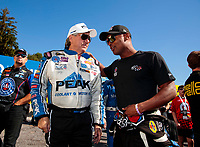 Sep 15, 2019; Mohnton, PA, USA; NHRA funny car driver John Force (left) with top fuel driver Antron Brown during the Reading Nationals at Maple Grove Raceway. Mandatory Credit: Mark J. Rebilas-USA TODAY Sports