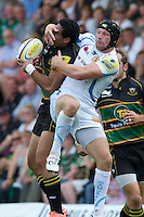 Matt Jess of Exeter Chiefs interferes with Ken Pisi of Northampton Saints as they both go for the high ball during the Aviva Premiership match between Northampton Saints and Exeter Chiefs at Franklin's Gardens on Sunday 9th September 2012 (Photo by Rob Munro)