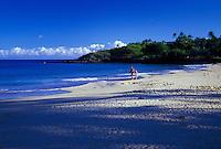 Father and daughter take a morning stroll along the shore of Hapuna Beach at Hapuna Beach State Park,   Norht Kona coast of Big Isle.
