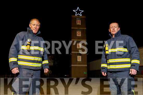 Firefighters Eamon Egan and Brian Nolan of the Castleisland Fire Station with their message of Hope displayed on the stations training tower on Thursday.