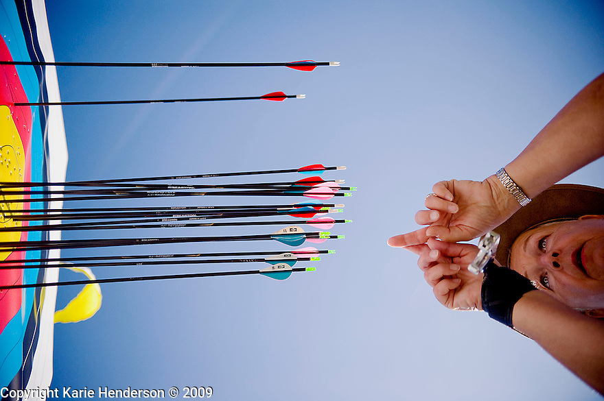 Connie Miller of Chino, CA, counts the points of her arrows at the Senior Games 2009, in Palo Alto, Calif., at Stanford Standium, Wednesday, August 05, 2009.