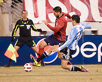 Clint Dempsey (8) of the United States tries to get past Marcos Rojo (24) of Argentina during an international friendly at New Meadowlands Stadium in East Rutherford, NJ.  The United States tied Argentina, 1-1.