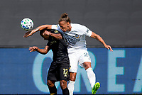 LOS ANGELES, CA - AUGUST 22: Diego Palacios #12 of LAFC and Rolf Feltscher #25  of the Los Angeles Galaxy battle for a ball during a game between Los Angeles Galaxy and Los Angeles FC at Banc of California Stadium on August 22, 2020 in Los Angeles, California.