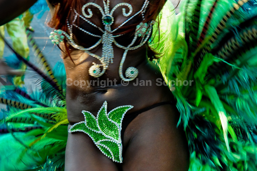 A Colombian girl, having a green feather costume, dances during the Carnival in Barranquilla, Colombia, 27 February 2006. The Carnival of Barranquilla is a unique festivity which takes place every year during February or March on the Caribbean coast of Colombia. A colourful mixture of the ancient African tribal dances and the Spanish music influence - cumbia, porro, mapale, puya, congo among others - hit for five days nearly all central streets of Barranquilla. Those traditions kept for centuries by Black African slaves have had the great impact on Colombian culture and Colombian society. In November 2003 the Carnival of Barranquilla was proclaimed as the Masterpiece of the Oral and Intangible Heritage of Humanity by UNESCO.