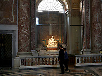 People stand by Michelangelo's Pieta while visiting St. Peter's Basilica as it reopens on May 18, 2020 at the Vatican. Italy is slowly lifting sanitary restrictions after a two-month coronavirus lockdown.<br /> UPDATE IMAGES PRESS/Isabella Bonotto<br /> <br /> STRICTLY ONLY FOR EDITORIAL USE