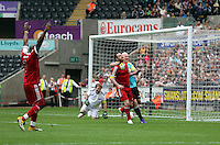 Pictured: Actor Adam Woodyatt from Eastenders (2nd L), conceding a goal from a penalty kick by Danny Dyer who is seen celebrating (2nd R). Sunday, 01 June 2014<br />