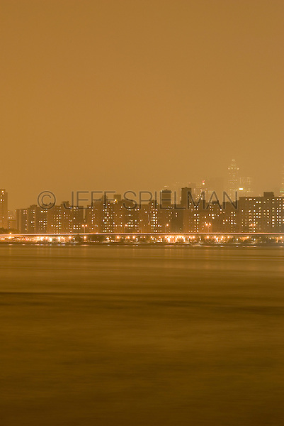 New York City - Apartment Buildings and East River Illuminated at Night