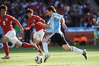 Lionel Messi turns on the speed in driving on the dribble into the South Korea penalty area. Argentina defeated South Korea, 4-1, in both teams' second match of play in Group B of the 2010 FIFA World Cup. The match was played at Soccer City in Johannesburg, South Africa June 17th.