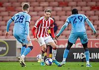 21st April 2021; Bet365 Stadium, Stoke, Staffordshire, England; English Football League Championship Football, Stoke City versus Coventry; Nick Powell of Stoke City under pressure from Julien Dacosta and Josh Eccles of Coventry City