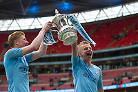 Oleksandr Zinchenko (right) & Kevin De Bruyne of Man City with FA Cup  during the FA Cup FINAL match between Manchester City and Watford at Wembley Stadium, London, England on 18 May 2019. Photo by Andy Rowland.<br /> .<br /> Editorial use only, license required for commercial use. No use in betting,<br /> games or a single club/league/player publications.'