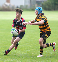 BALLYMENA ACADEMY vs RBAI | Saturday 19th September 2015<br /> <br /> Ethan Field closes in for a tackle during the a schools friendly fixture at Ballymena Academy, Ballymena, County Antrim, Northern Ireland.<br /> <br /> Photo credit: John Dickson / DICKSONDIGITAL