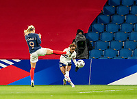 LE HAVRE, FRANCE - APRIL 13: Eugenie Le Sommer #9 of France defends Crystal Dunn #19 of the USWNT during a game between France and USWNT at Stade Oceane on April 13, 2021 in Le Havre, France.