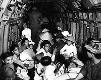 Stunned by the viciousness of a Viet Cong attack on their village, Vietnam war refugees ride an Air Force helicopter to a safe area near Saigon.  March 1966.  Air Force.  (USIA)<br /> EXACT DATE SHOT UNKNOWN<br /> NARA FILE #:  306-MVP-22-10<br /> WAR & CONFLICT BOOK #:  407