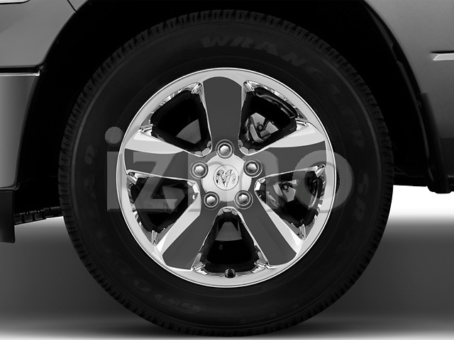 Tire and wheel close up detail view of a 2013 Dodge RAM 1500 Big Horn Crew Cab