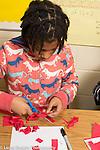 Education elementary school Grade 4 girl doing math activity